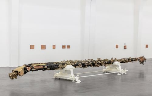 """Lodgepole pine, cast copper, brass, and lead, cast polycaprolactone, 39 × 427 × 105 in, Installation view: """"Matthew Barney: Redoubt"""", UCCA Center for Contemporary Art, Beijing, September 28, 2019 – January 12, 2020; Courtesy UCCA Center for Contemporary Art, BeijingLaurenz Foundation, Basel"""